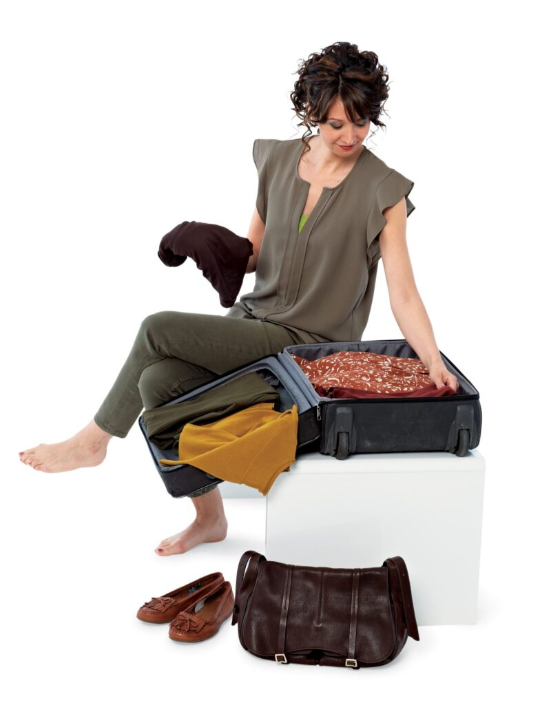 Lady packing suitcase