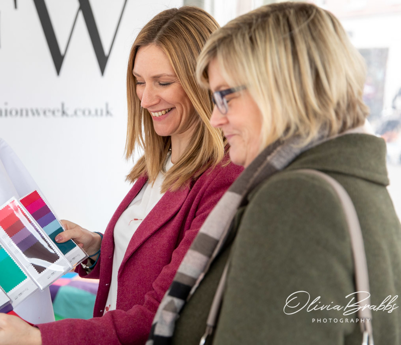 Toni carver showing colour swatch wallet to client