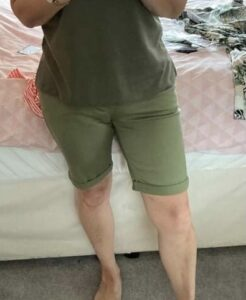 Client in her fitted, tailored shorts