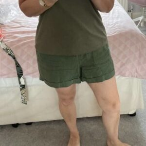 Client in her standard baggy shorts